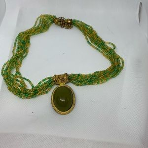 Green beaded necklace with focal piece